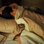 sleeping_with_cat-320x213